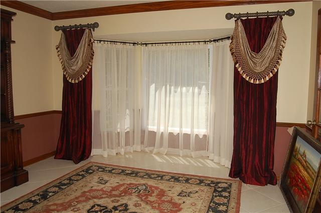 fixed panel with attached valance across bay window - Custom Window Treatments